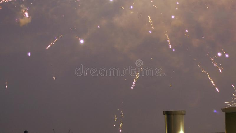 Firework over city at night with Fireworks over Manhattan stock photography