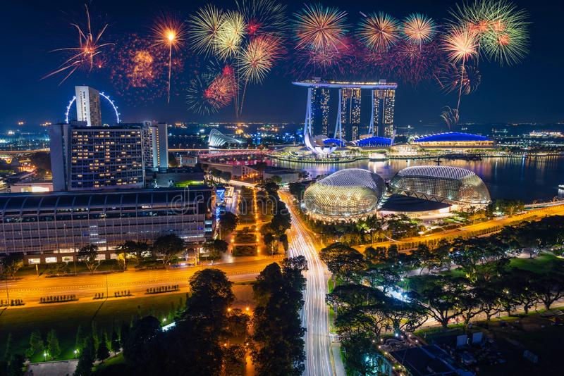 Firework over Singapore Skyline and view of skyscrapers on Marin stock photography