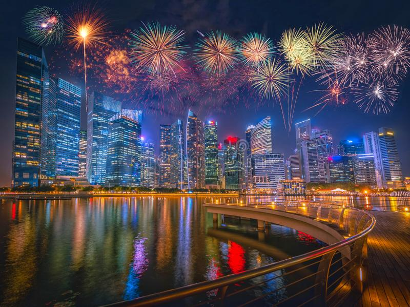 Firework over Singapore Skyline and view of skyscrapers on Marin stock photos
