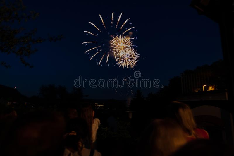 Firework with spectators on the 4th of july at jugendfest brugg 2019. View of the fireworks with spectators in foreground from the square Törlirain on the 4th stock photos