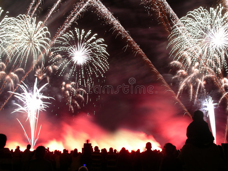 Fireworks. In a  contest with a silhouetted crowd watching in the foreground stock photos