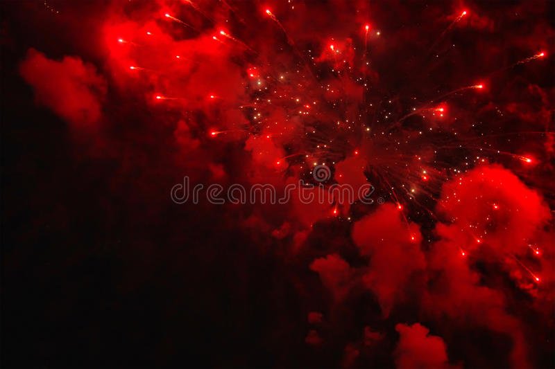 Fireworks. Photo of red fireworks in sky at nigth royalty free stock photo