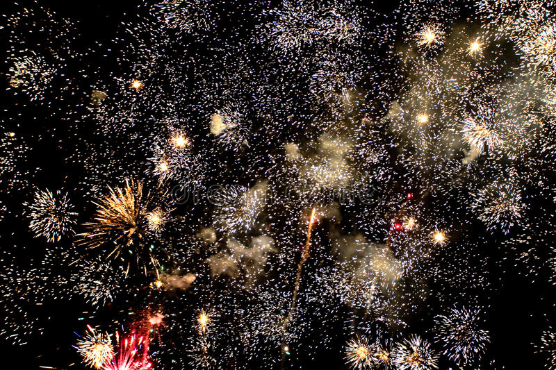 Fireworks. White fireworks festival in the night stock photography