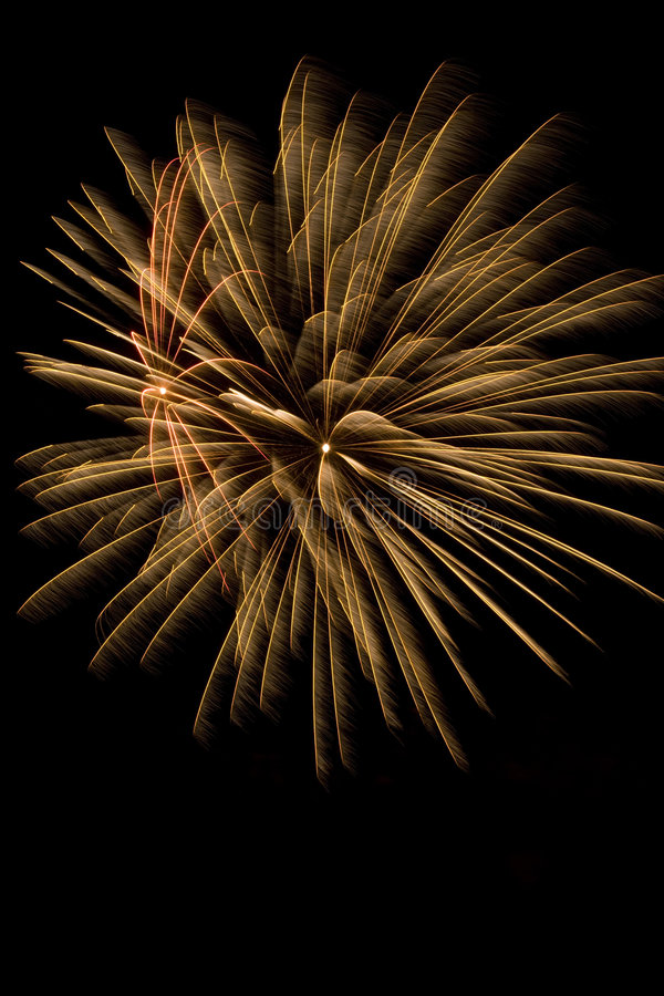 Beautiful fireworks display lights up the nighttime sky. Beautiful fireworks display fills the nighttime sky stock image