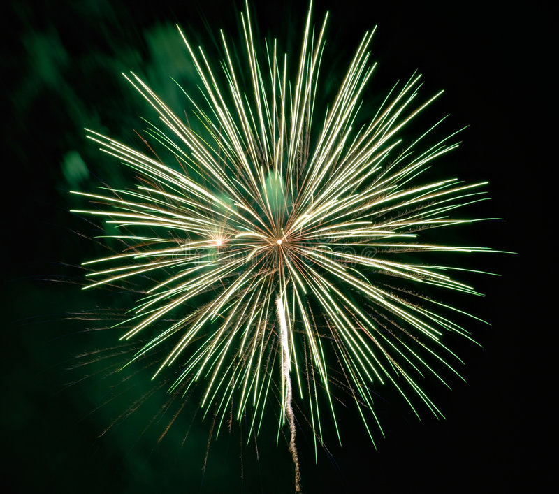 Fireworks. A big burst of green fireworks royalty free stock photos