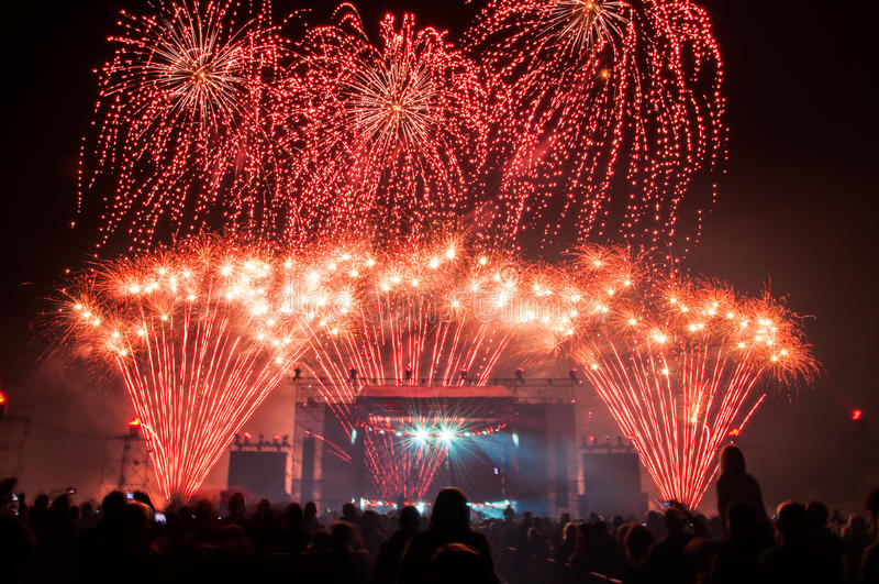 Fireworks above the stage during concert. Colorful fireworks above the stage during concert stock photography