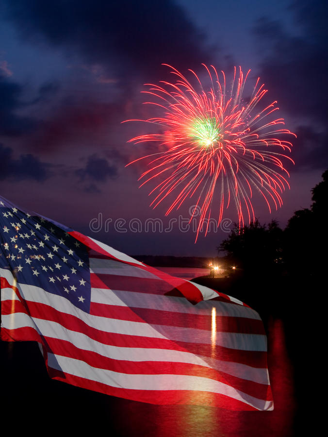 Fireworks and American Flag. The American Flag comes to life with this powerful fireworks display. Great for the 4th of July stock images