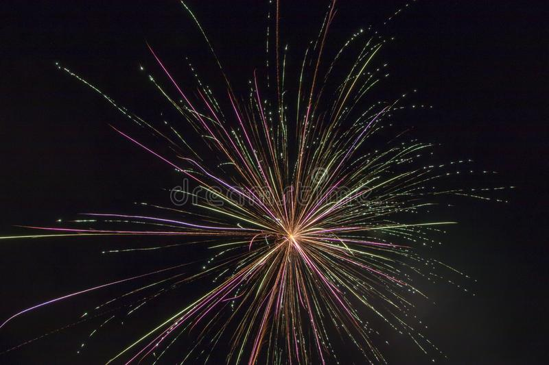 Fireworks on a black canvas. Light trails from a fireworks explosive blast illuminating the black sky long exposure of a firework display on a holiday stock photos