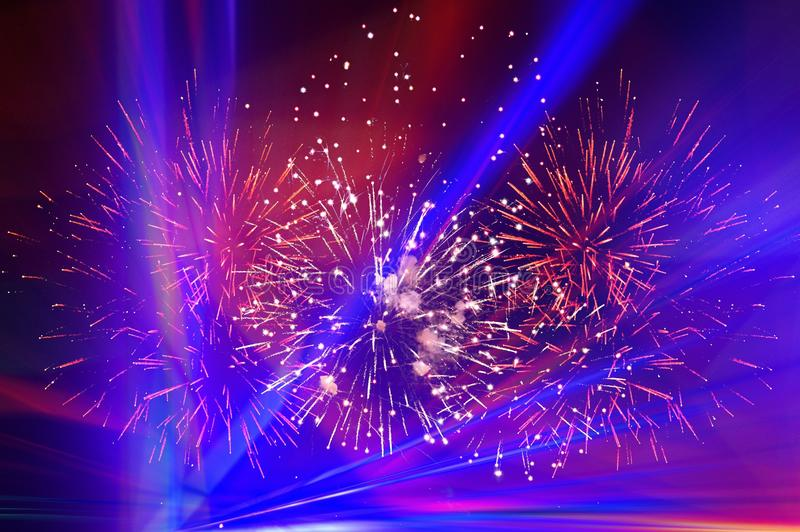 Fireworks and blue light on night sky royalty free stock images