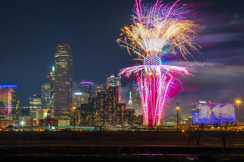 Fireworks burst from the Reunion Tower on New Year`s in Dallas Texas. Fireworks are shot from the Reunion Tower in Dallas Texas on January 1st, 2019. Most of the royalty free stock image