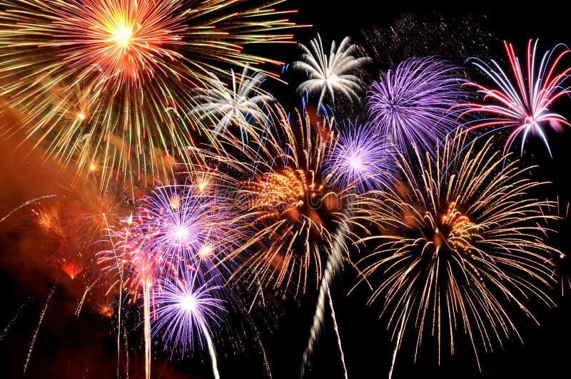 Fireworks bursting. Fireworks of various colors bursting against a black background royalty free stock image
