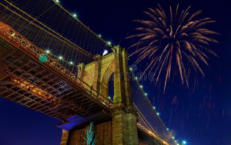 Fireworks bursting from the Brooklyn bridge at dusk royalty free stock photo