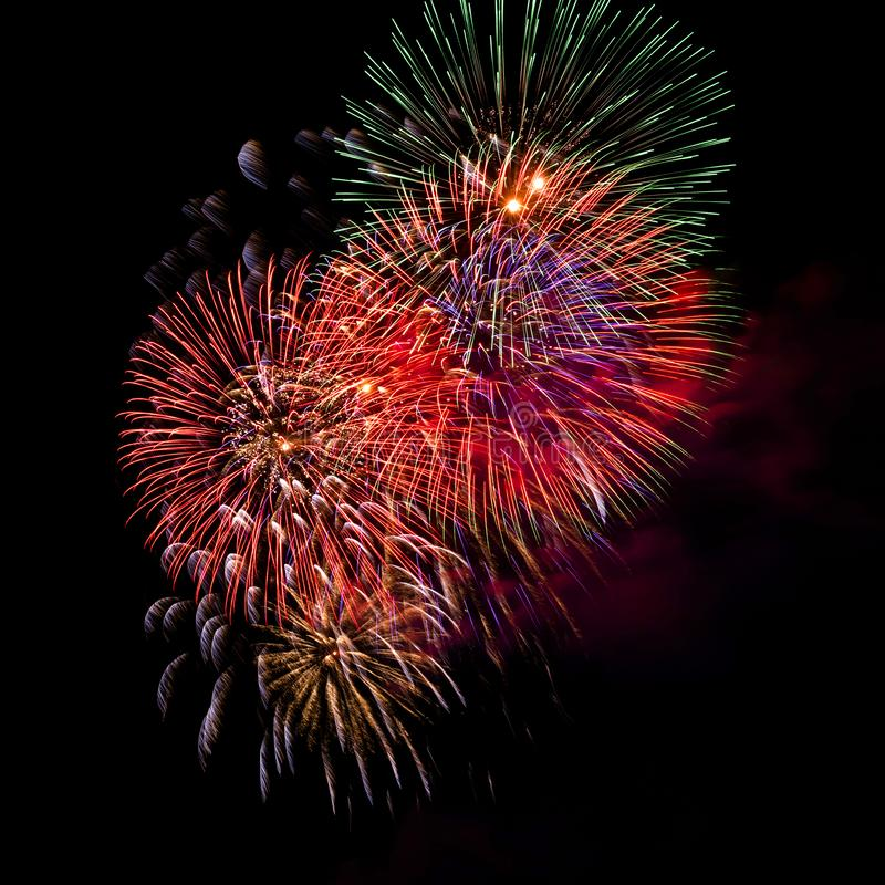 Fireworks Bursting in Night Sky with Copyspace royalty free stock images