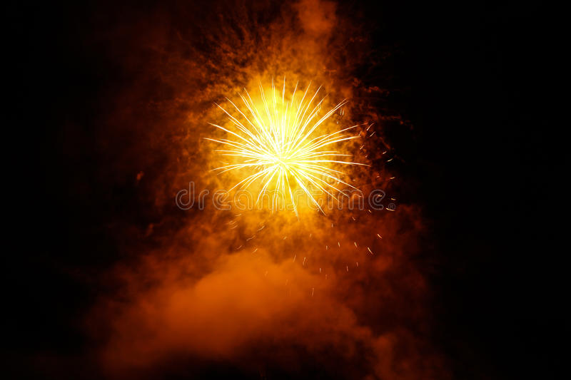 Fireworks. Bursting fireworks surounded by smoke royalty free stock images