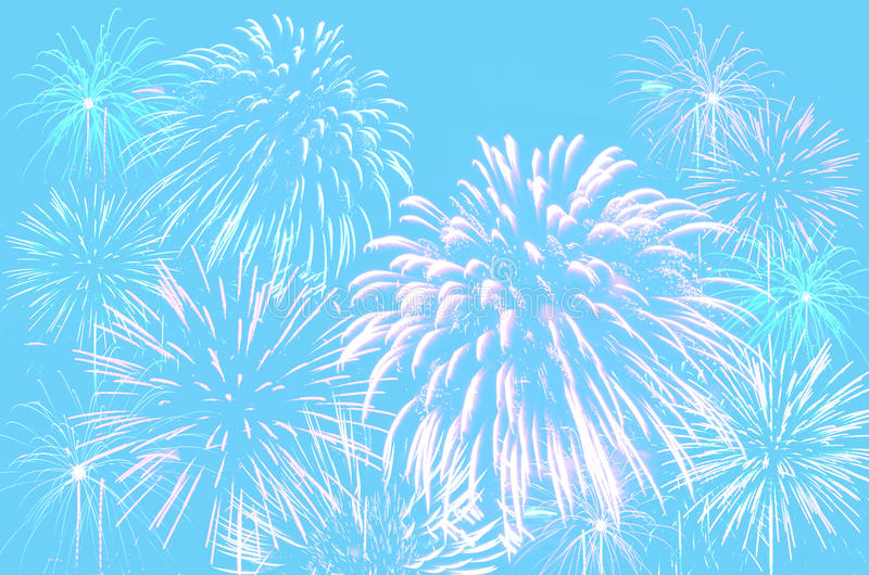 Fireworks celebration on pastel cyan color background. royalty free stock photo