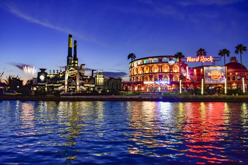 Fireworks , Chocolate Emporium restaurant and Hard Rock Cafe on blue night background at Universal Studios area . stock photography