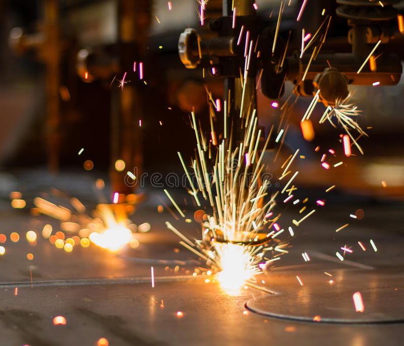 Fireworks of CNC LPG gas cutting stock images