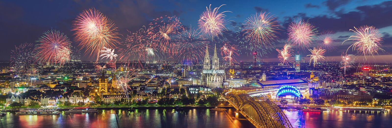 Fireworks at Cologne Skyline with Cathedral and Hohenzollern Bridge, Cologne, Germany. View of the Cologne Skyline at new years eve with amazing fireworks over royalty free stock photography