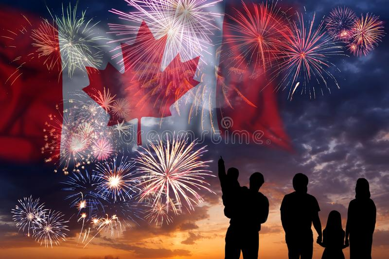 Fireworks on day of Canada. People looks holiday fireworks on independence day, flag of Canada in sky, background and banner stock photography