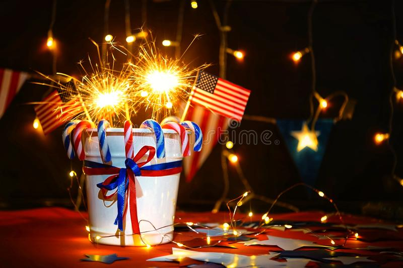 Fireworks display celebrates the independence Day of the United States of America nation on the fourth of July with the us flag ,. Sparklers , candy, on the red stock photography