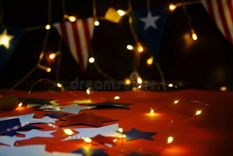Fireworks display celebrates the independence Day of the United States of America nation on the fourth of July with the us flag ,. Sparklers , candy, on the red stock images