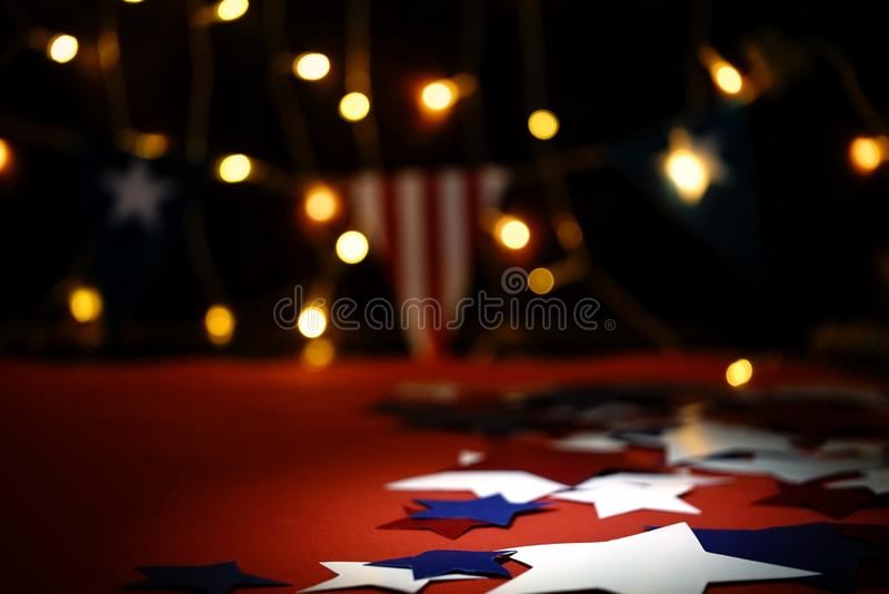Fireworks display celebrates the independence Day of the United States of America nation on the fourth of July with the us flag ,. Sparklers , candy, on the red royalty free stock images