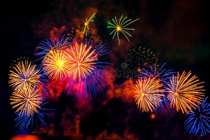 Fireworks display on dark sky background. Colored fireworks display as flowers on dark sky background stock photos