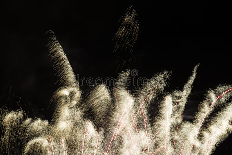 Fireworks display. Golden and silver fireworks against black sky royalty free stock photography