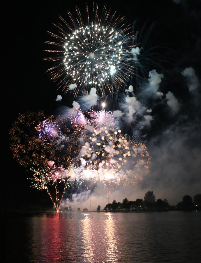 Fireworks Display. A large fireworks display over water royalty free stock photography