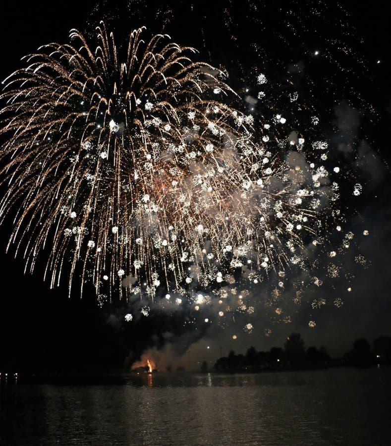 Fireworks Display Light Up The Sky. A fireworks display lights up the sky at night stock photography