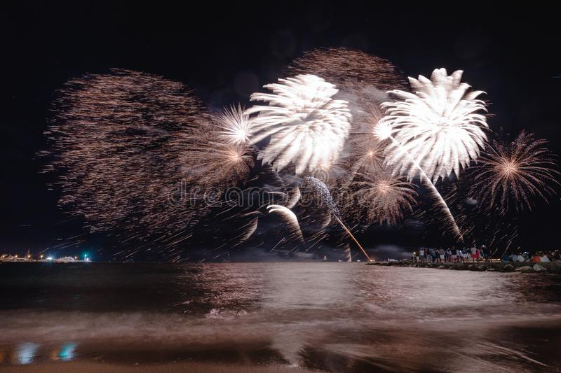 Fireworks display, night show on seafront, pyrotechnic festival. Antibes Juan les Pins. French Riviera royalty free stock photo