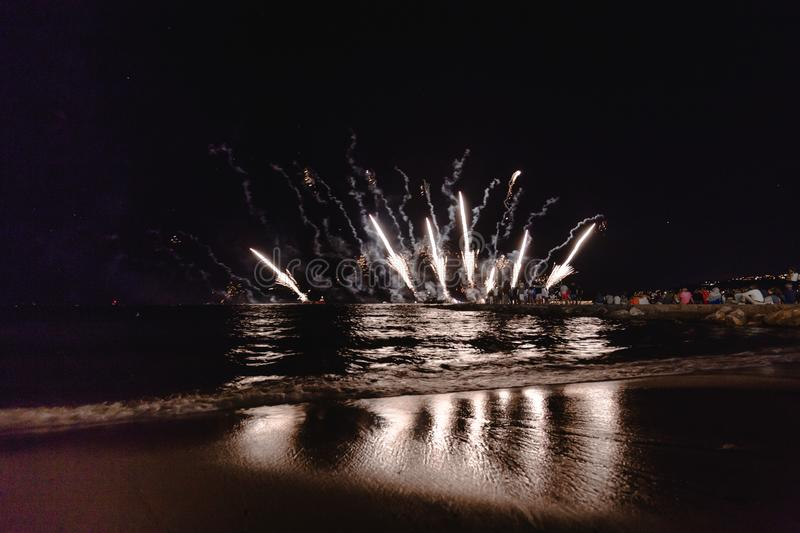 Fireworks display, night show on seafront, pyrotechnic festival. Antibes Juan les Pins stock photo