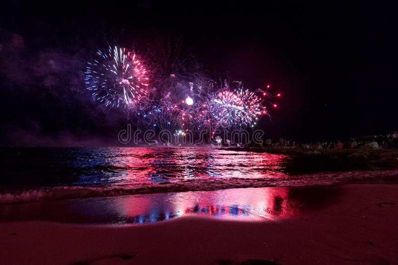 Fireworks display, night show on seafront, pyrotechnic festival. Antibes Juan les Pins. French Riviera royalty free stock photography