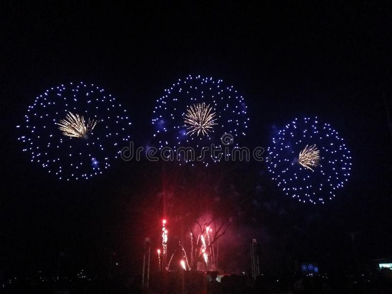 Fireworks display: three is a company stock photography
