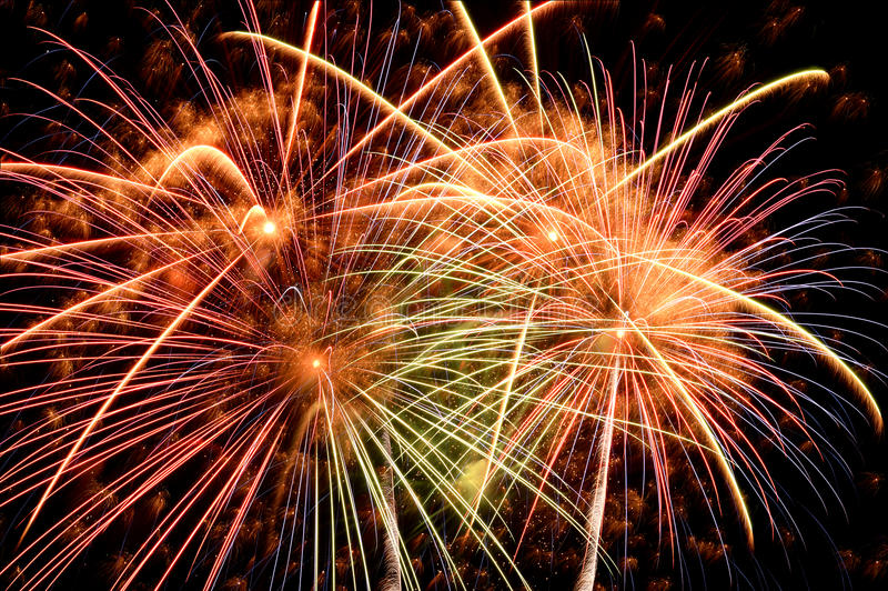 Fireworks of diverse colors at night royalty free stock photos
