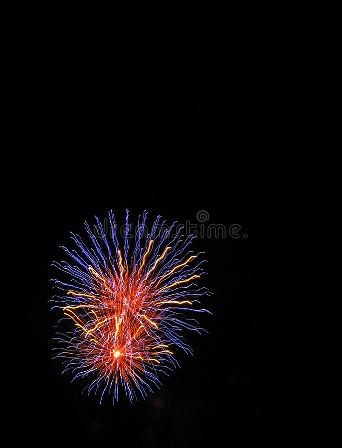 Fireworks at event. The photograph represent two colorful Fireworks on black background. Perfect for use in corporate applications, communications, business royalty free stock photo