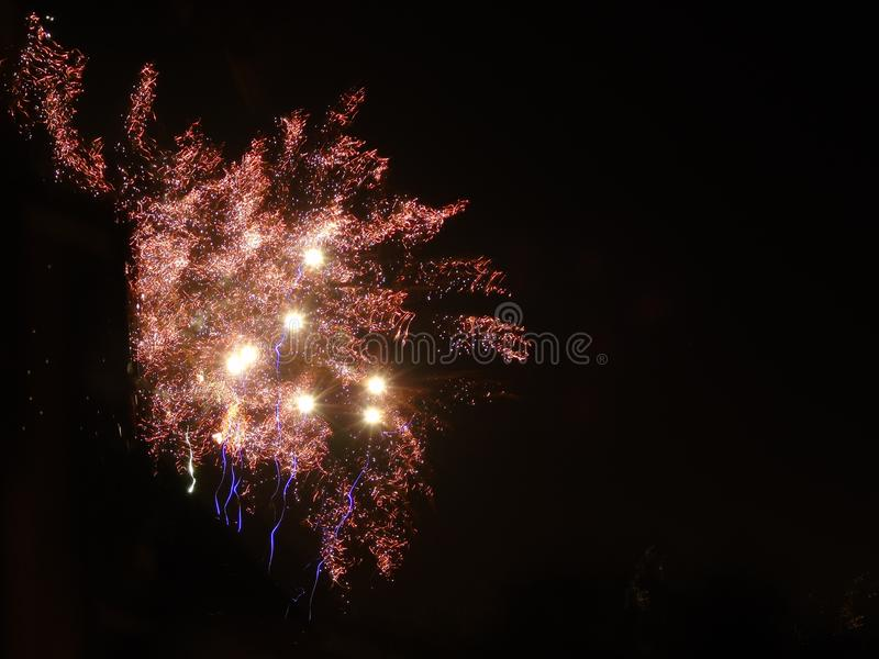 Fireworks explode over Dunfermlines dark skies royalty free stock photo