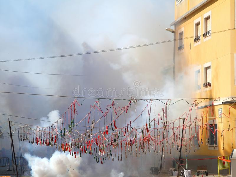 Fireworks firecrackers exploding in smoke street stock images