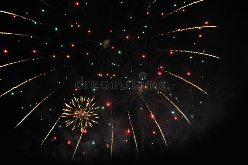 Fireworks. Firework. Heavenly background. Amazing festoon of twinkling sparkling lights in the night sky during the New Year and stock images