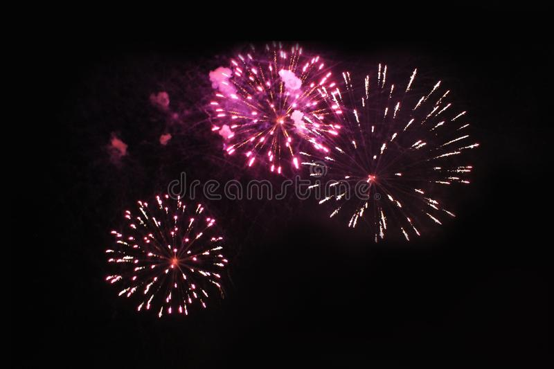 Fireworks. Firework. Heavenly background. Amazing trio of bright red and yellow sparkling lights in the night sky during the royalty free stock photos