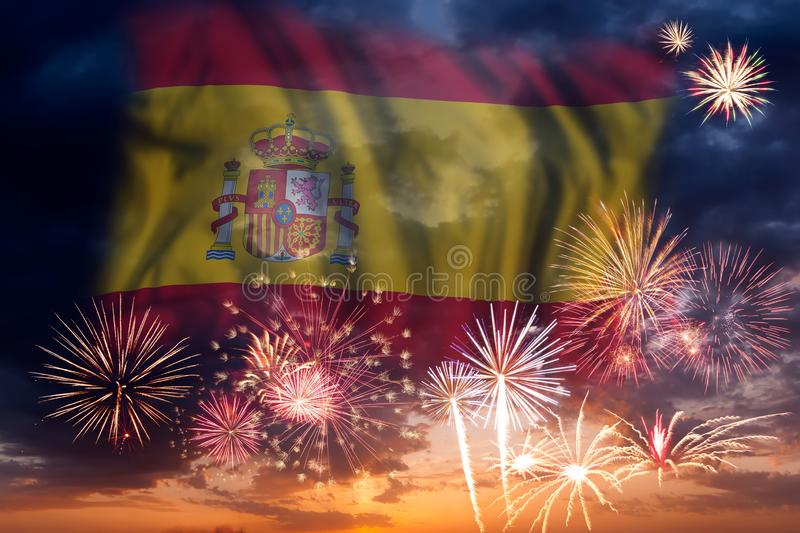 Fireworks and flag of Spain. Holiday sky with fireworks and flag of Spain, independence day royalty free stock photography