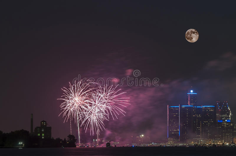 Fireworks with full moon over detroit river royalty free stock photo