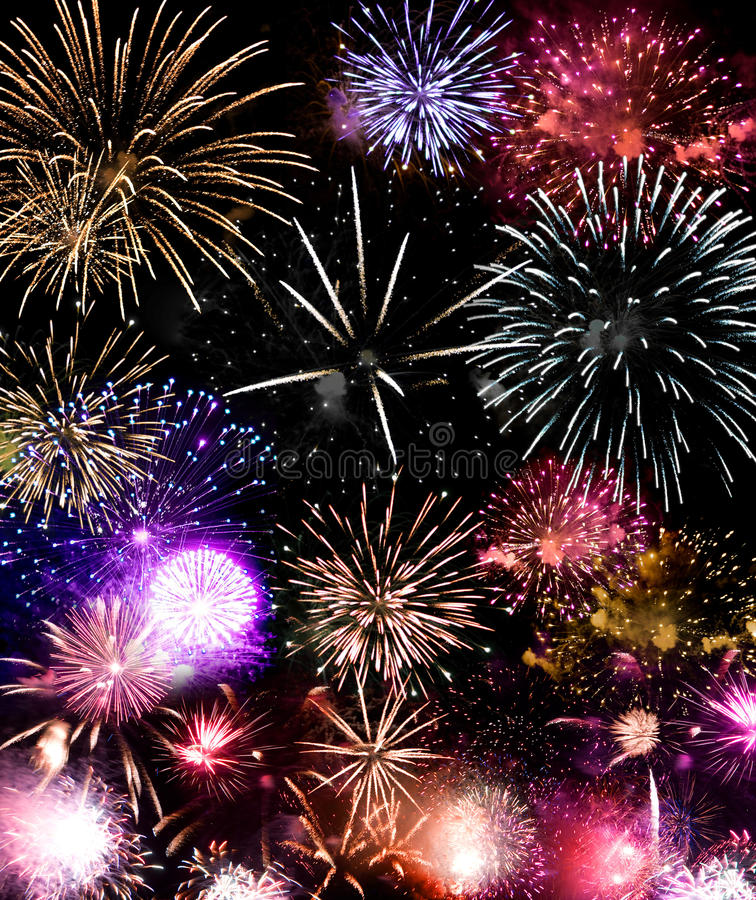 Fireworks Grand Finale. Beautiful fireworks exploding over a dark night sky in a grand finale display. Very high resolution stock photos