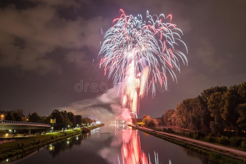 Fireworks of the Herbstdult with Ferris wheel and cathedral in Regensburg, Germany.  stock photography