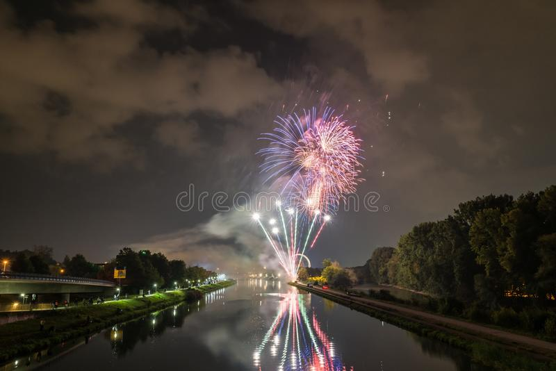 Fireworks of the Herbstdult with Ferris wheel and cathedral in Regensburg, Germany.  stock images