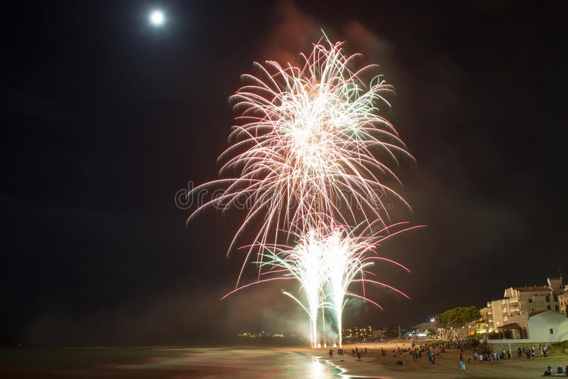 Fireworks. Holiday fireworks at marine coast stock photo