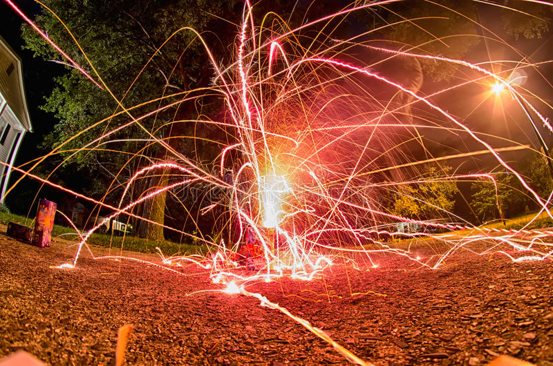 Fireworks at home in a driveway royalty free stock image