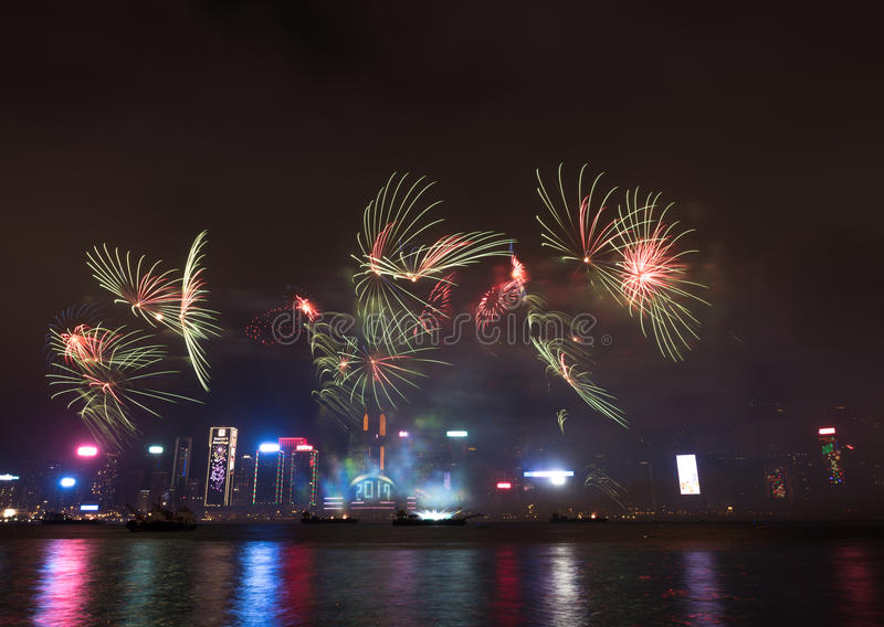 Fireworks in Hong Kong New Year celebration 2017 at Victoria Harbor. View from Tsim Sha Tsui stock photography