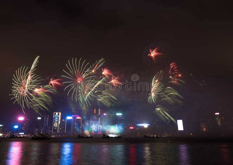 Fireworks in Hong Kong New Year celebration 2017 at Victoria Harbor. View from Tsim Sha Tsui royalty free stock photography