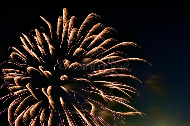 Fireworks illuminate night sky on independence day. Vibrant colors of fireworks display light up night sky on independence day royalty free stock photos